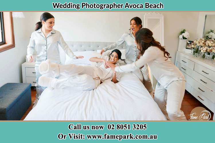 Photo of the Bride and the bridesmaids playing on bed Avoca Beach NSW 2251
