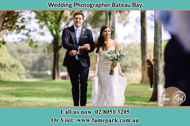 Photo of the Bride and the Groom walking in the yard Bateau Bay