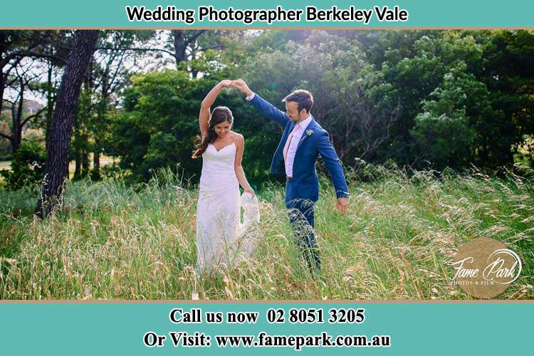 Photo of the Groom and the Bride dancing on the fields Berkeley Vale