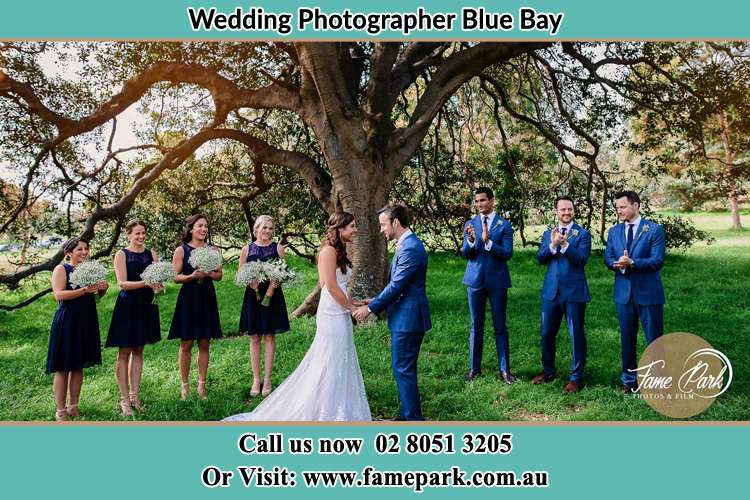 Photo of bride and groom with their entourage Blue Bay