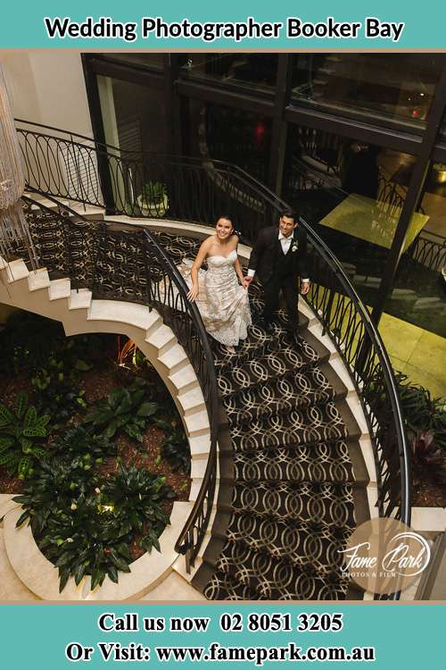 Photo of the Bride and Groom going down the stairs Booker Bay