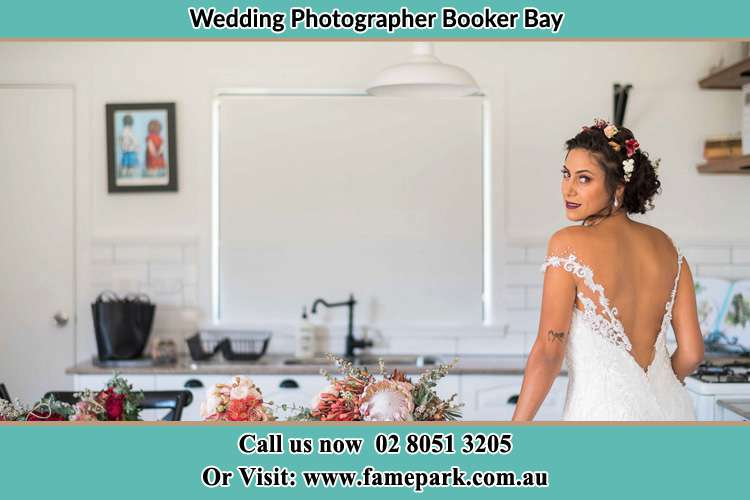 The Bride looked back to pose for the camera Largs Booker Bay