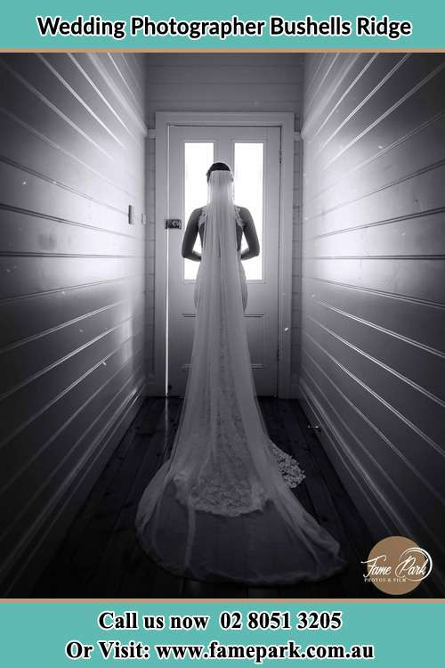 Photo of the Bride waiting for her wedding behind a closed door Bushells Ridge