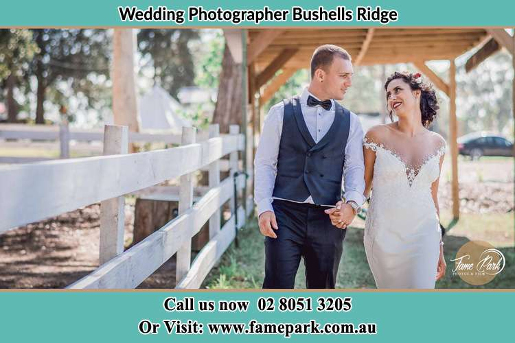 Photo of the Groom and the Bride holding hands while walking Bushells Ridge NSW 2259