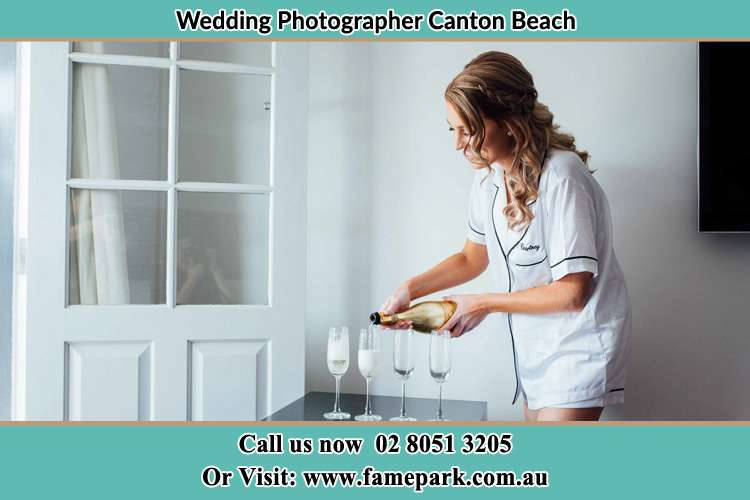 Photo of the Bride pouring wine the glasses Canton Beach NSW 2263