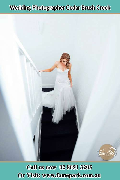 Photo of the Bride going down the stair Cedar Brush Creek NSW 2259