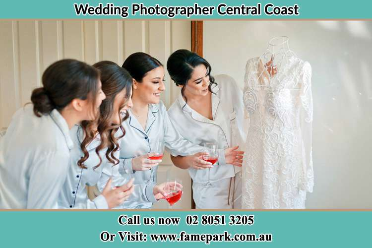 Bride looking at the gown with the girls Central Coast