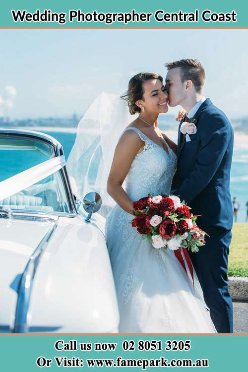 Groom kiss the Bride in the car Central Coast