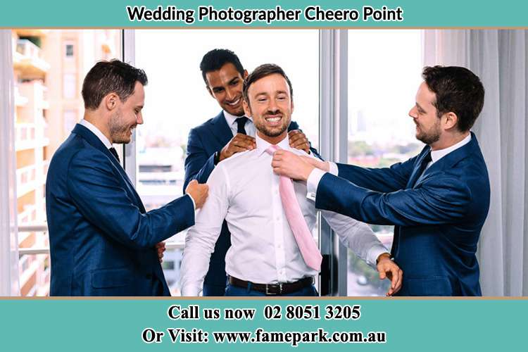 Photo of the Groom helping by the groomsmen getting ready Cheero Point NSW 2083