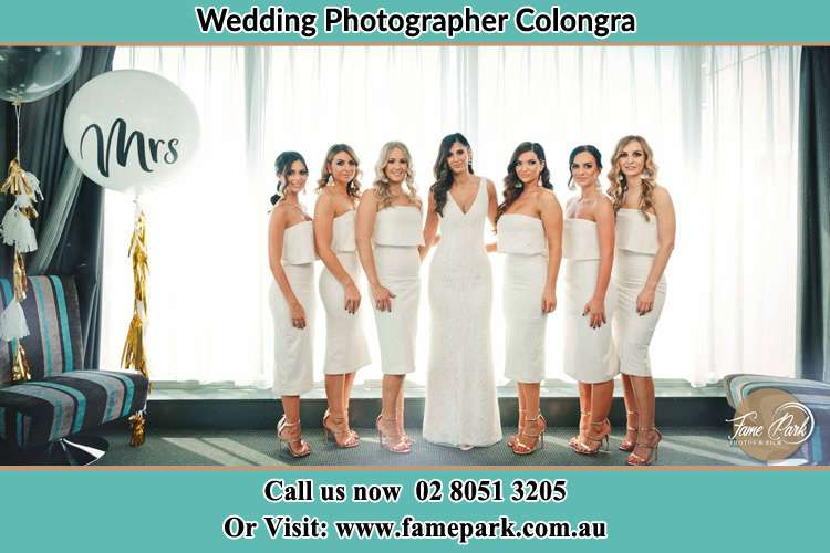 The Bride and her bridesmaids posed for the camera Colongra
