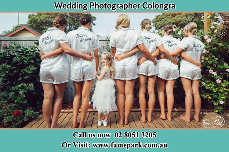 Behind photo of the Bride and the bridesmaids with the flower girl looking back Colongra NSW 2262