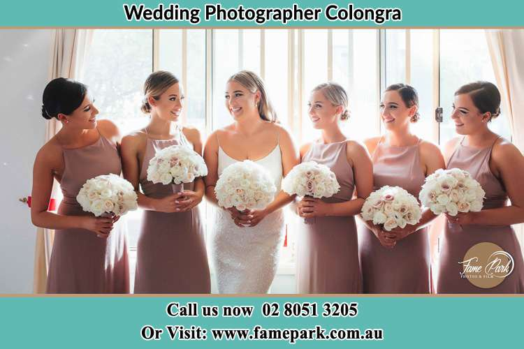 Photo of the Bride and her bridesmaids each holding a bouquet of flowers Colongra