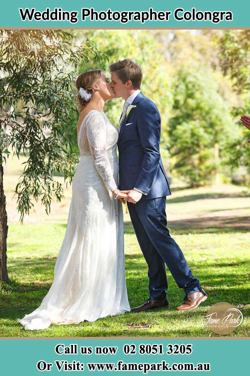 Photo of the Bride and the Groom kissing at the yard Copacabana NSW 2251
