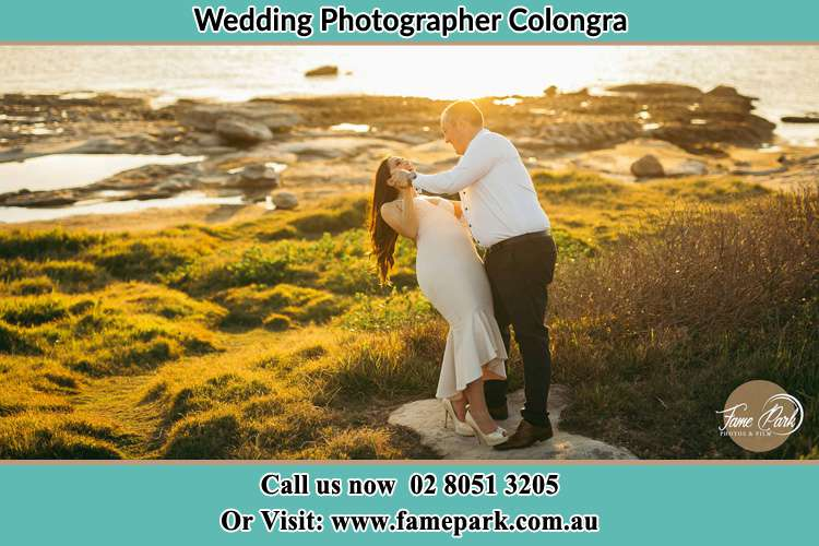 Photo of the Bride and the Groom dancing near the lake Copacabana NSW 2251
