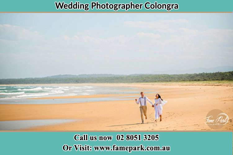 Photo of the Groom and the Bride walking near the sea front Colongra NSW 2262