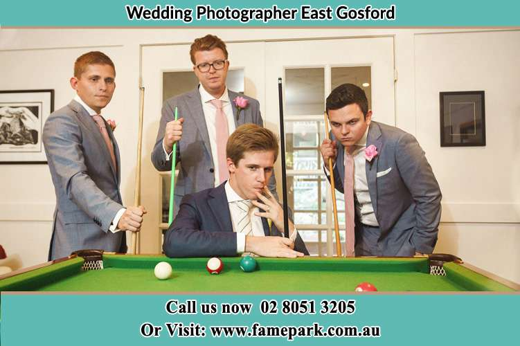 Photo of the Groom and the groomsmen playing billiards East Gosford NSW 2250
