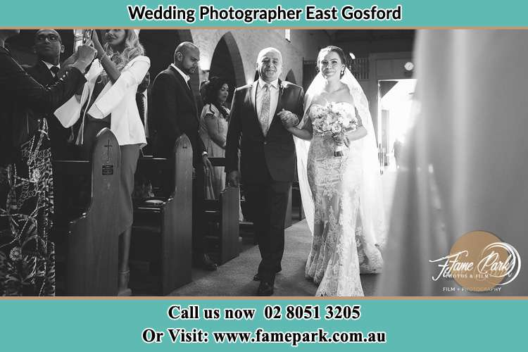 Photo of the Bride with her father walking down the aisle East Gosford
