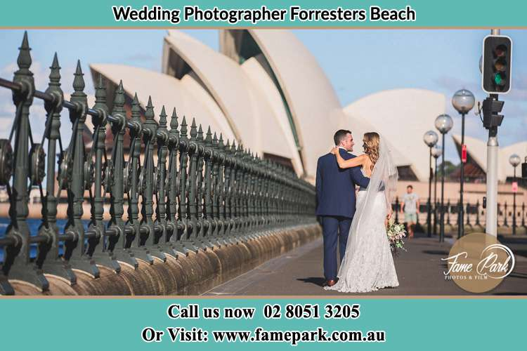 The Groom and the Bride walking towards the Sydney Grand Opera House Forresters Beach NSW 2260