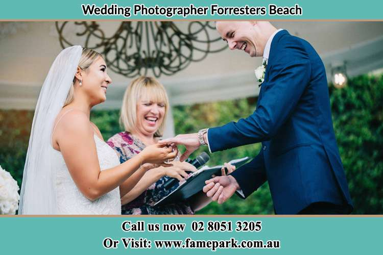 Photo of the bride wearing ring to the Groom Forresters Beach NSW 2260
