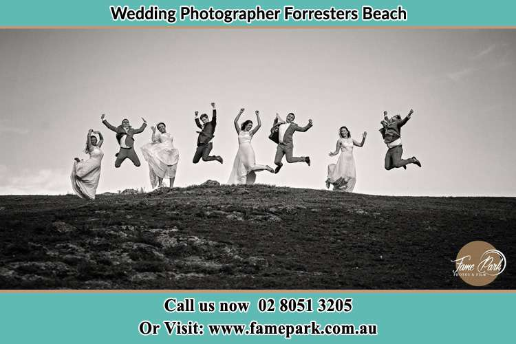 Jump shot photo of the Groom and the Bride with the entourage Forresters Beach NSW 2260