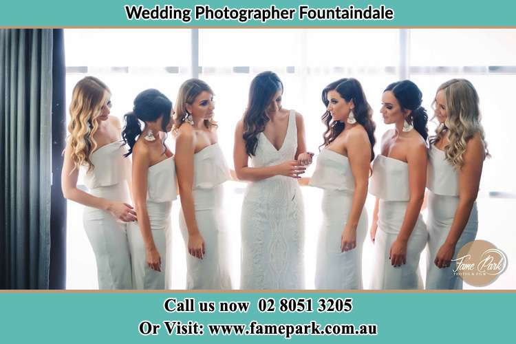 Photo of the Bride checking her ring as her bridesmaids looked on Fountaindale