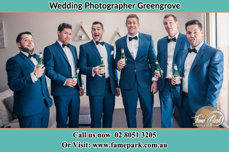 The groom and his groomsmen striking a wacky pose in front of the camera Greengrove NSW 2250