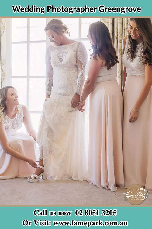 The Bride Fitting the shoes with the help of secondary sponsor Greengrove
