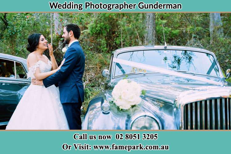 Photo of the Bride and the Groom besides the bridal car Gunderman NSW 2775