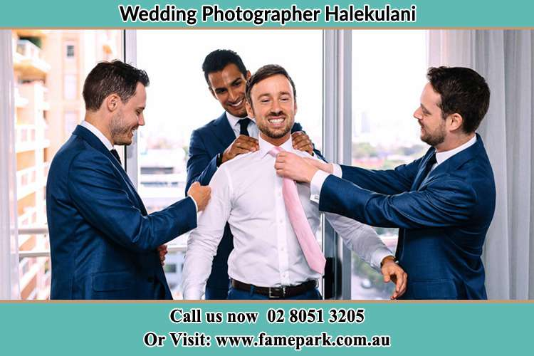 Photo of the Groom helping by the groomsmen getting ready Halekulani NSW 2262