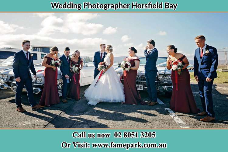 The entourage watch as the new couple kiss Horsfield Bay