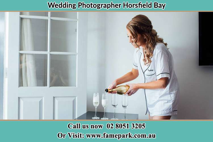 Photo of the Bride pouring wine to the glasses Horsfield Bay NSW 2256