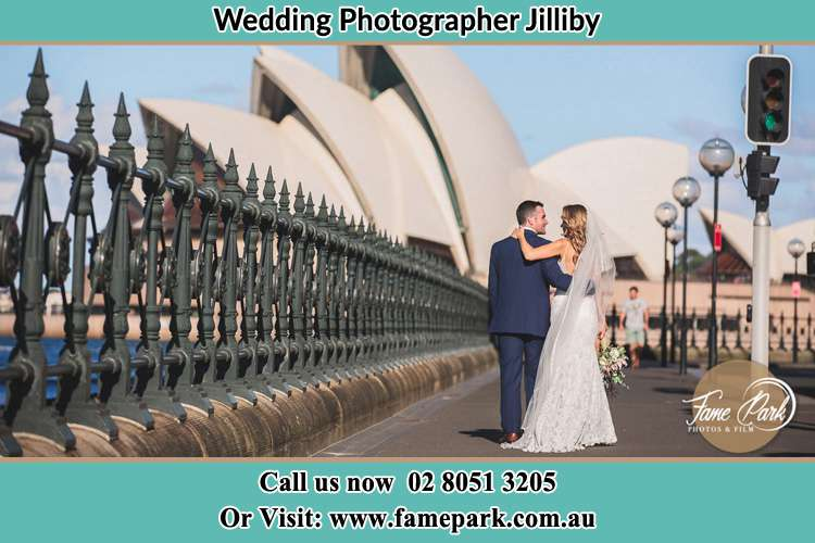 The Groom and the Bride walking towards the Sydney Grand Opera House Jilliby NSW 2259
