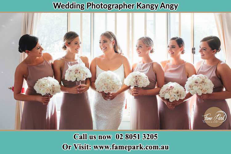 Photo of the Bride and the bridesmaids holding flower bouquet Kangy Angy NSW 2258