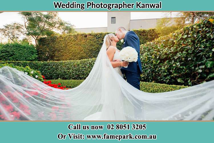 Photo of the Bride and the Groom kissing at the garden Kanwal NSW 2259