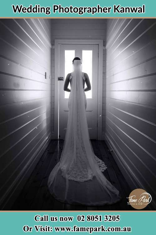 Photo of the Bride waiting for her wedding behind a closed door Kanwal