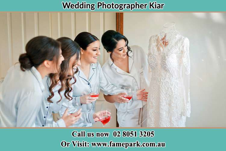 Photo of the Bride and the bridesmaids checking the bridal gown Kiar NSW 2259