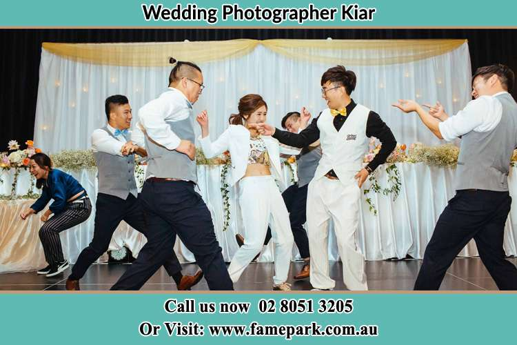 Photo of the Bride and the Groom dancing with the groomsmen Kiar NSW 2259