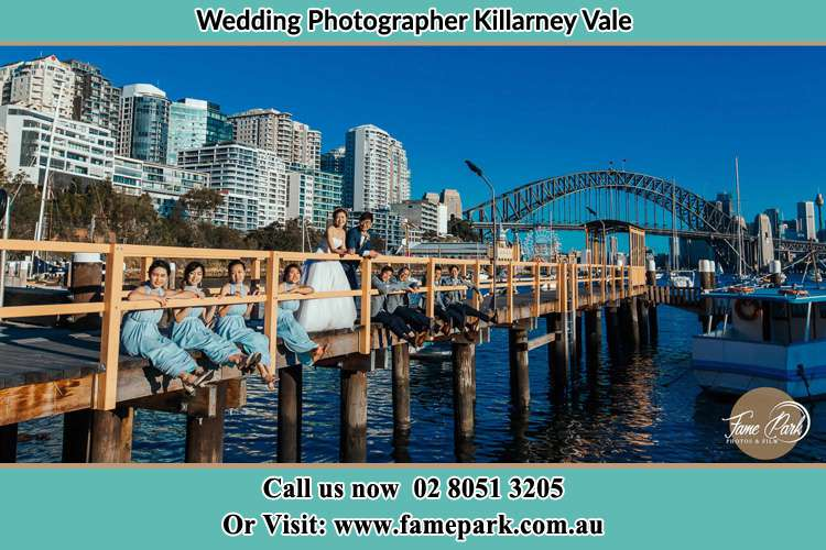 Photo of the Groom and the Bride with the entourage at the bridge Killarney Vale NSW 2261