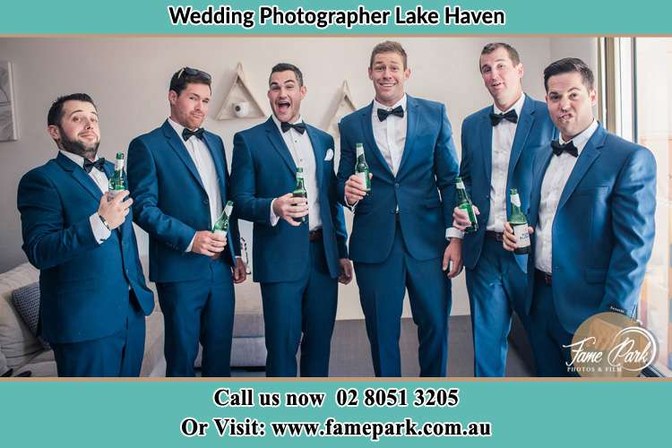 The groom and his groomsmen striking a wacky pose in front of the camera Lake Haven NSW 2263