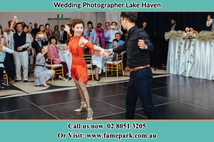 Photo of the Bride and the Groom dancing on the dance floor Lake Haven NSW 2263