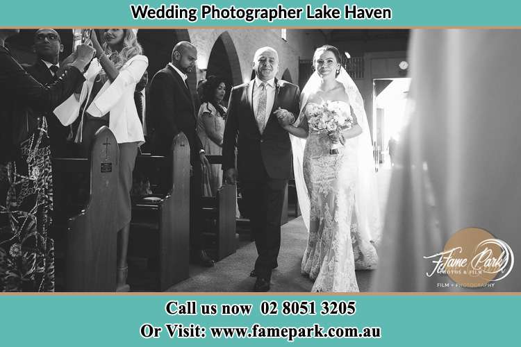 Photo of the Bride with her father walking the aisle Lake Haven NSW 2263