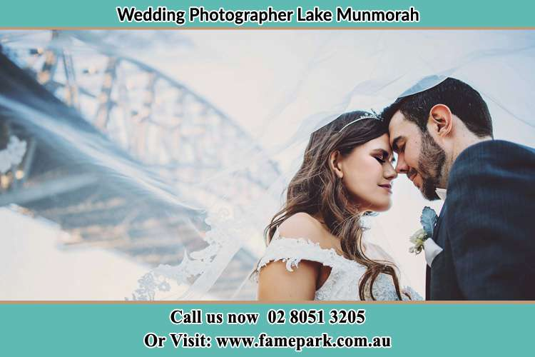 Close up photo of the Bride and the Groom under the bridge Lake Munmorah NSW 2259