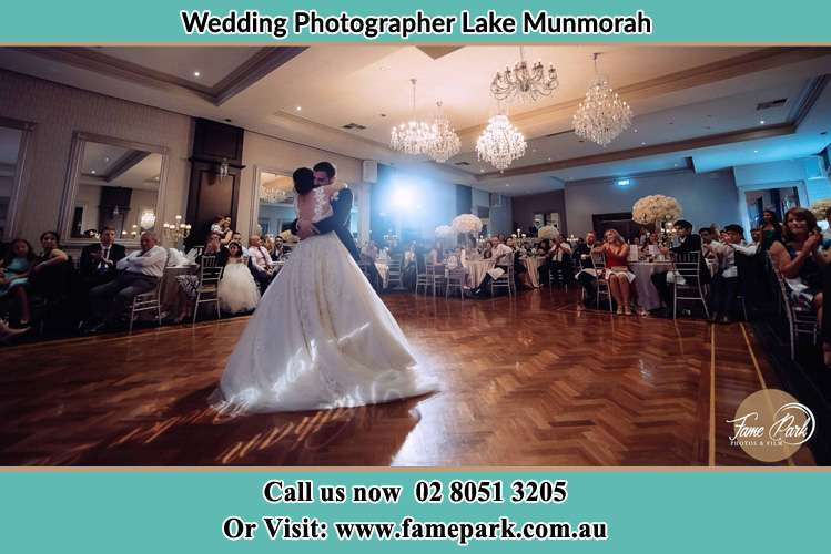 Photo of the Bride and the Groom hugging on the dance floor Lake Munmorah NSW 2259