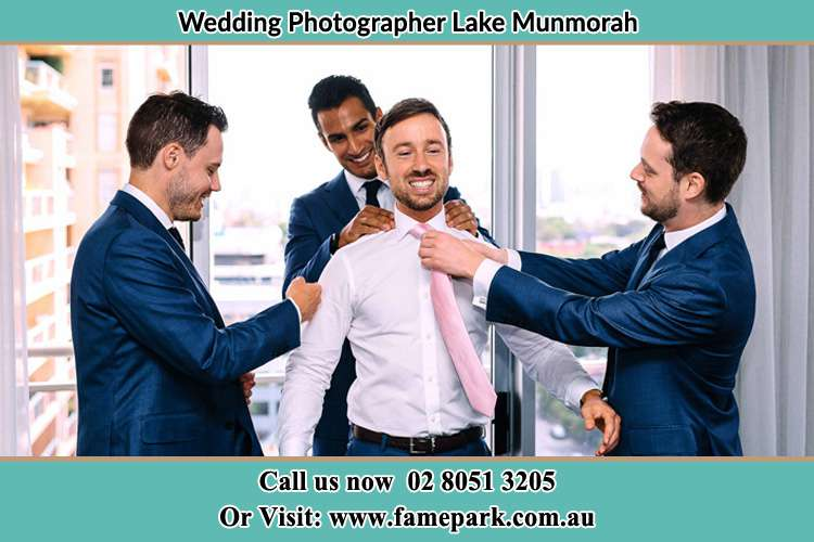 Photo of the Groom helping by the groomsmen getting ready Lake Munmorah NSW 2259