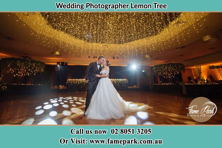 Photo of the Groom and the Bride kissing on the dance floor Lemon Tree NSW 2259