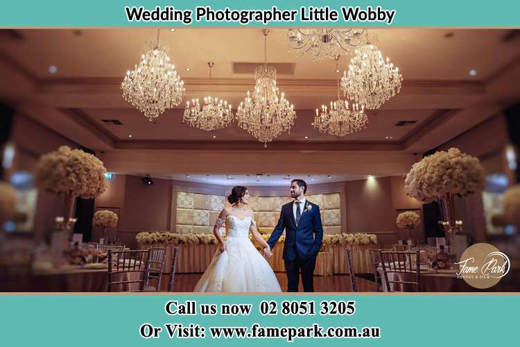 Photo of the Bride and the Groom holding hands on the dance floor Little Wobby NSW 2256