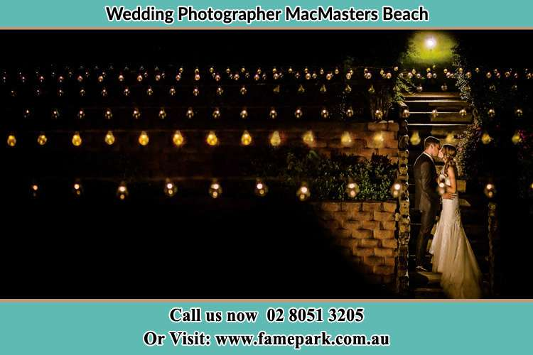Photo of the Groom and the Bride kissing MacMasters Beach NSW 2251