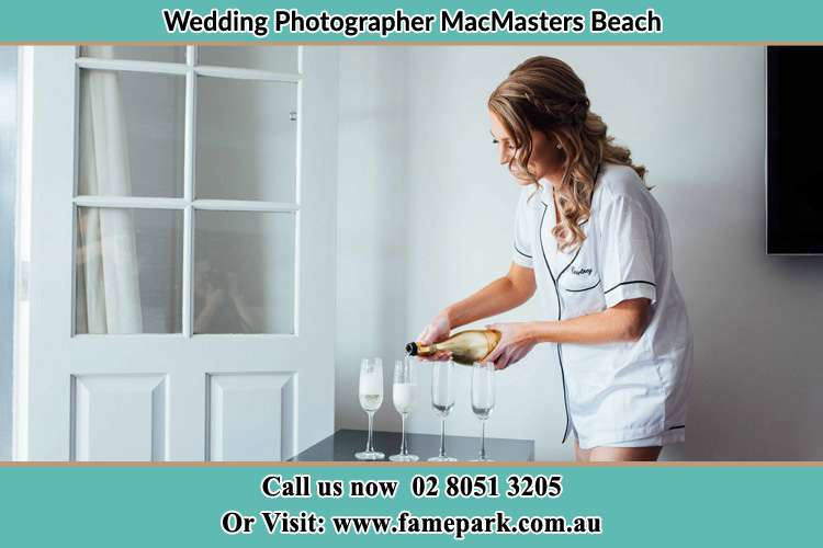 Photo of the Bride pouring wine on the glasses MacMasters Beach NSW 2251