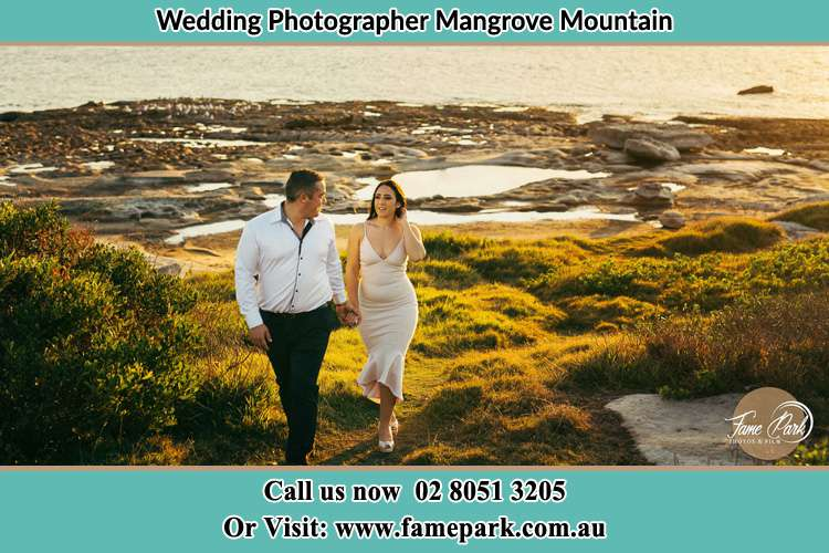 Photo of the Groom and the Bride walking near the lake Mangrove Mountain NSW 2250