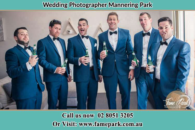 The groom and his groomsmen striking a wacky pose in front of the camera Mannering Park NSW 2250